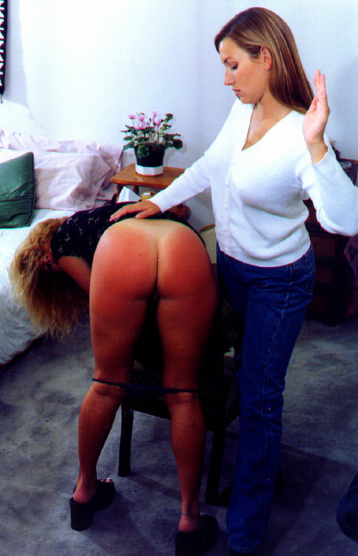 free spanking picture girl gets strapped on her bare ass